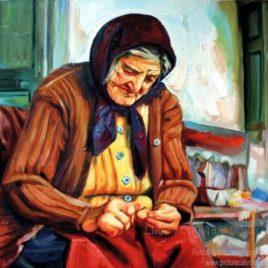 Bătrână pe prispă